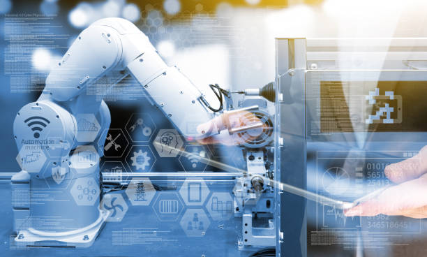 Industry4.0 concept .Business man holding tablet with industry graphic sign and blue tone of automate wireless Robot arm in smart factory background. Double exposure , blue tone , flare light stock photo
