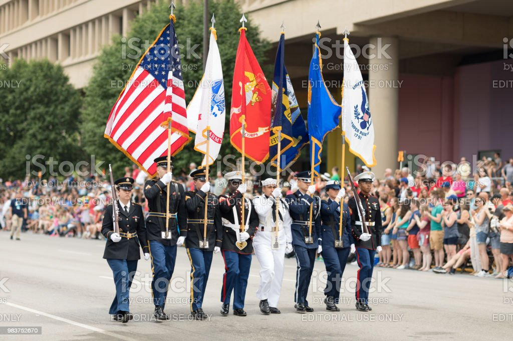 Indy 500 Parade 2018 Indianapolis, Indiana, USA - May 26, 2018, Members of the USA Military carry the American flag at Indy 500 Parade Air Force Stock Photo