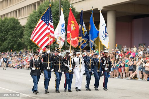 Indianapolis, Indiana, USA - May 26, 2018, Members of the USA Military carry the American flag at Indy 500 Parade