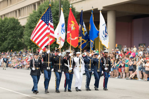 Indy 500 Parade 2018 Indianapolis, Indiana, USA - May 26, 2018, Members of the USA Military carry the American flag at Indy 500 Parade air force stock pictures, royalty-free photos & images
