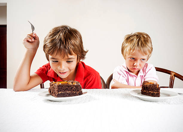 inequality concept, large slice small serving. - big cake stock photos and pictures