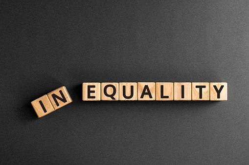 Inequality to equality - word from wooden blocks with letters