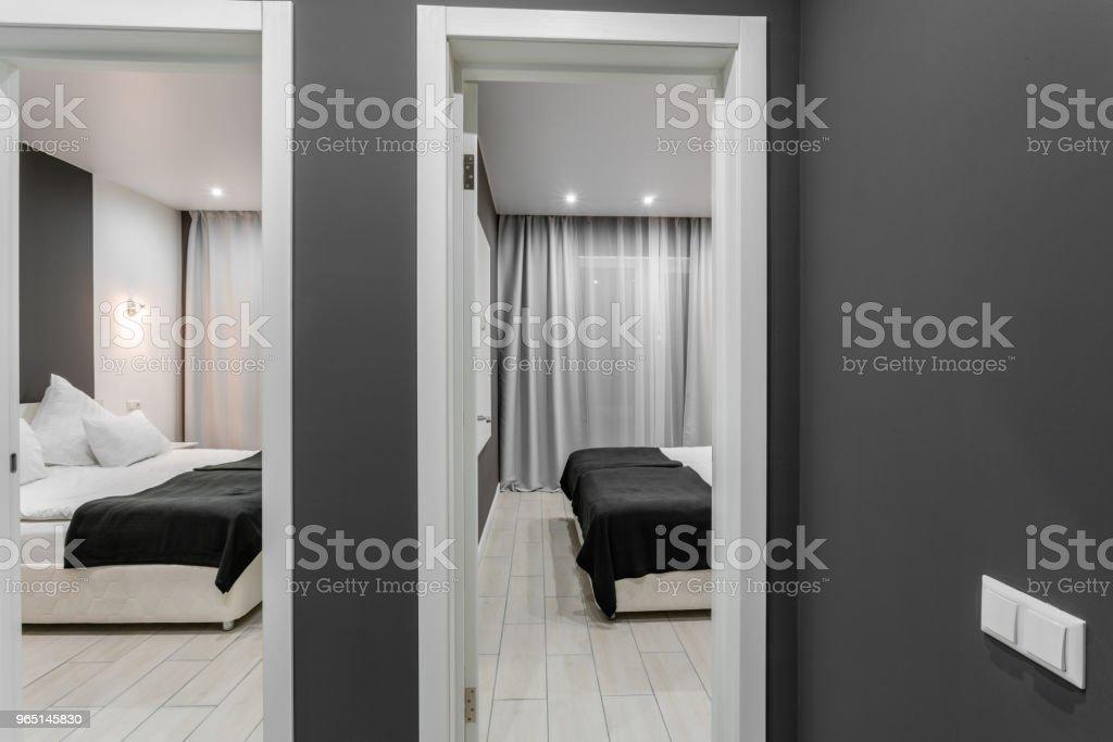 inexpensive family room. Hotel standart two bedroom. simple and stylish interior. interior lighting zbiór zdjęć royalty-free
