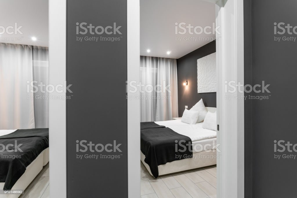 inexpensive family room. Hotel standart two bedroom. simple and stylish interior. interior lighting royalty-free stock photo