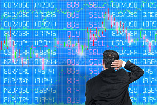 Inexperienced foreign exchange trader scratching head stock photo
