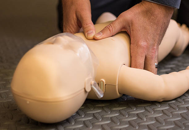 Infant and Child CPR First Aid and CPR for Children and Infants aha stock pictures, royalty-free photos & images