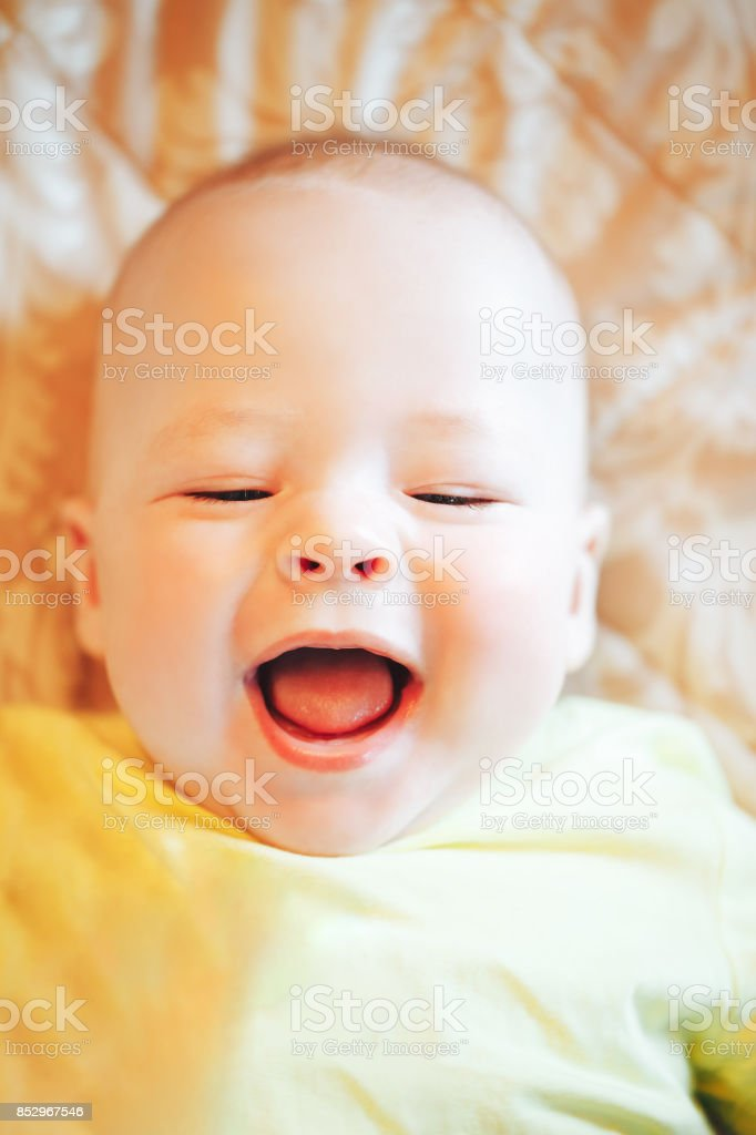 Infant Baby Child Boy Six Months Old Shows Emotions stock photo