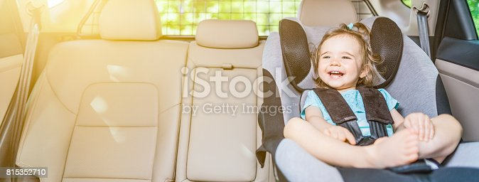 istock Infant baby girl buckled into her car seat. 815352710