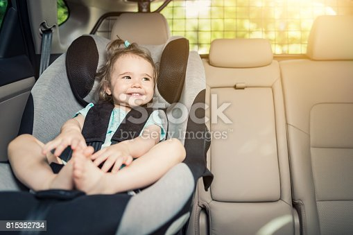 istock Infant baby girl buckled into her car seat. 815352734