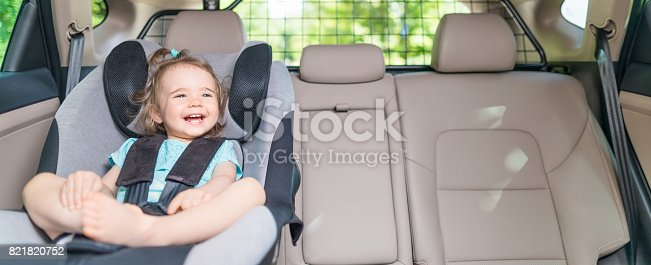 istock Infant baby girl buckled into her car seat. 821820752
