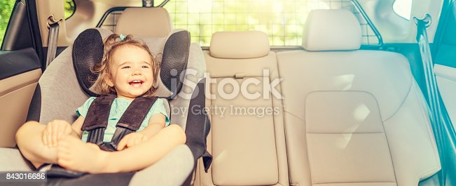 istock Infant baby girl buckled into her car seat. 843016686