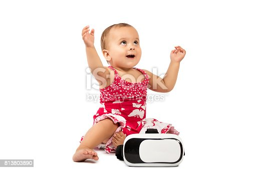 1019302738istockphoto infant baby uses virtual reality (VR cardboard) isolated on white background 813803890