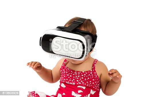 1019302738istockphoto infant baby uses virtual reality (VR cardboard) isolated on white background 813803926
