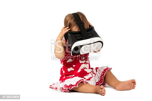 1019302738istockphoto infant baby uses virtual reality (VR cardboard) isolated on white background 813803968