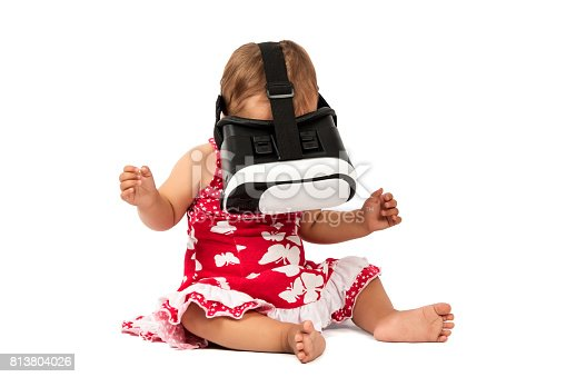 1019302738istockphoto infant baby uses virtual reality (VR cardboard) isolated on white background 813804026