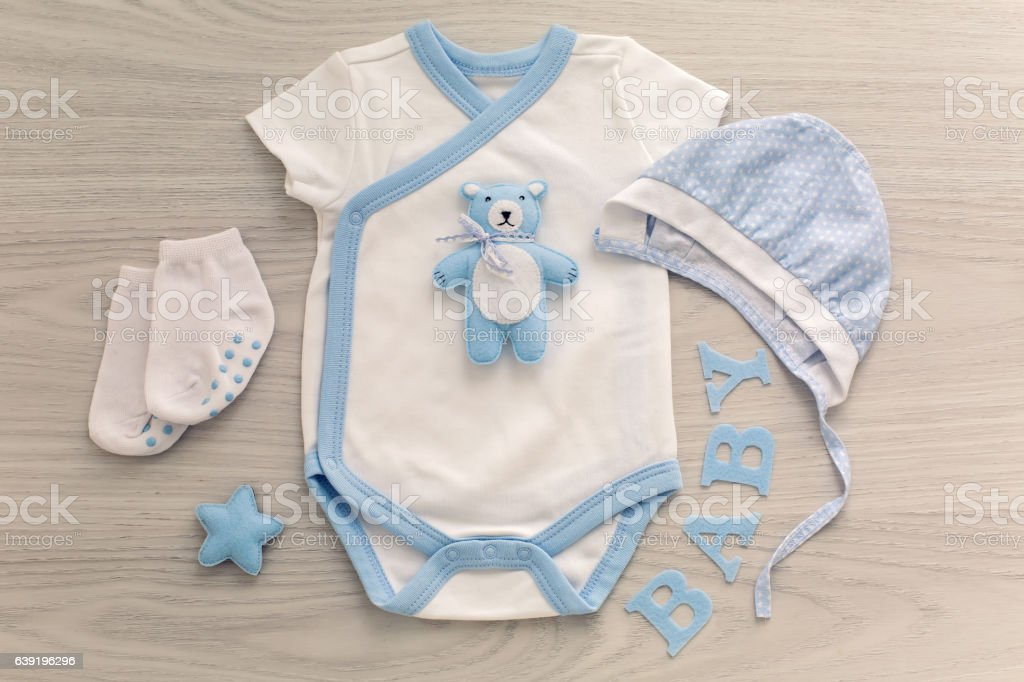 infant bodysuit with matching hat and socks stock photo