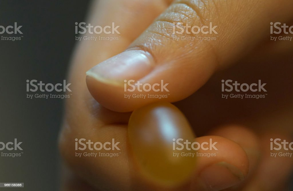 infant hand with medication - Royalty-free Addiction Stock Photo