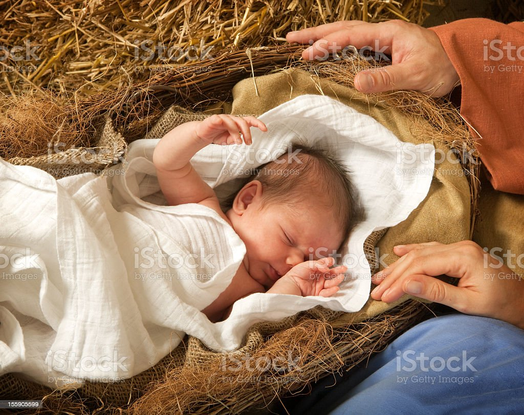 Infant in a manger reenacting birth of Christ stock photo