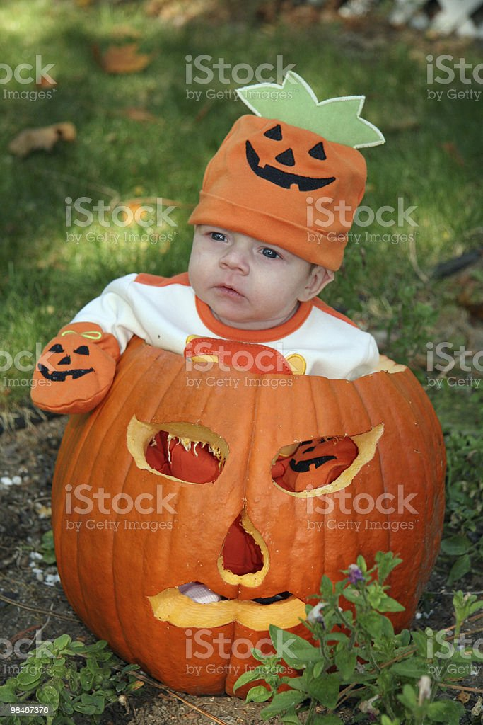 Infant in a pumpkin royalty-free stock photo