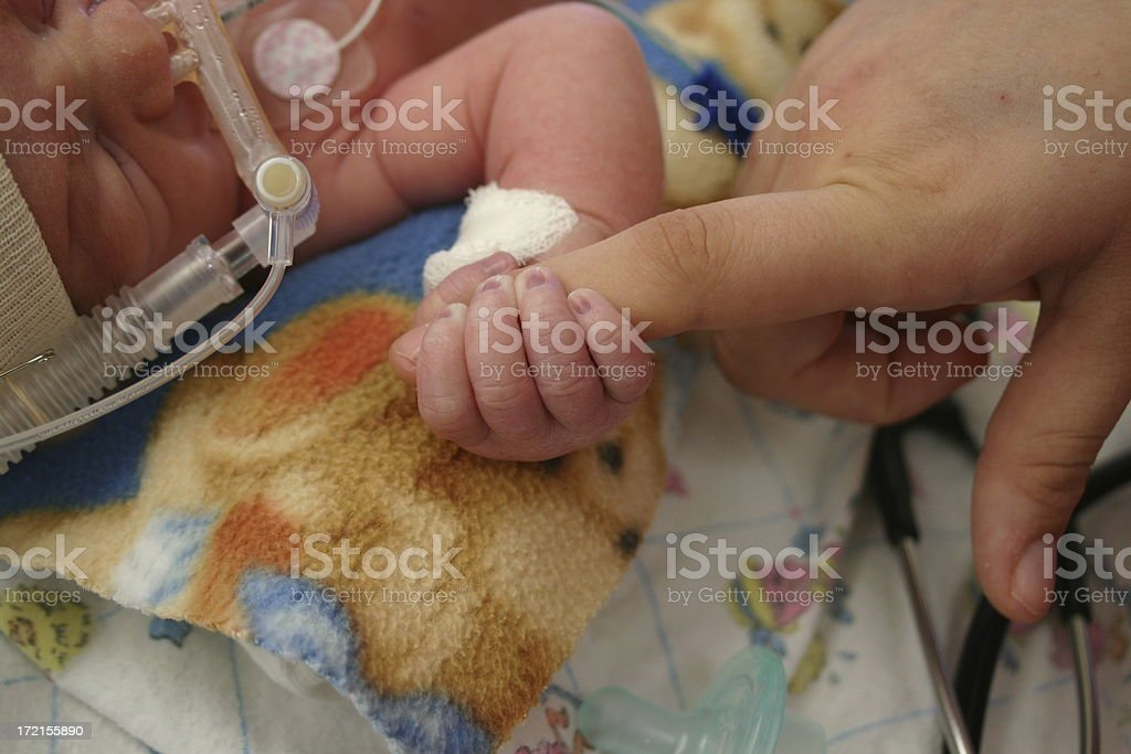 infant in hospital stock photo