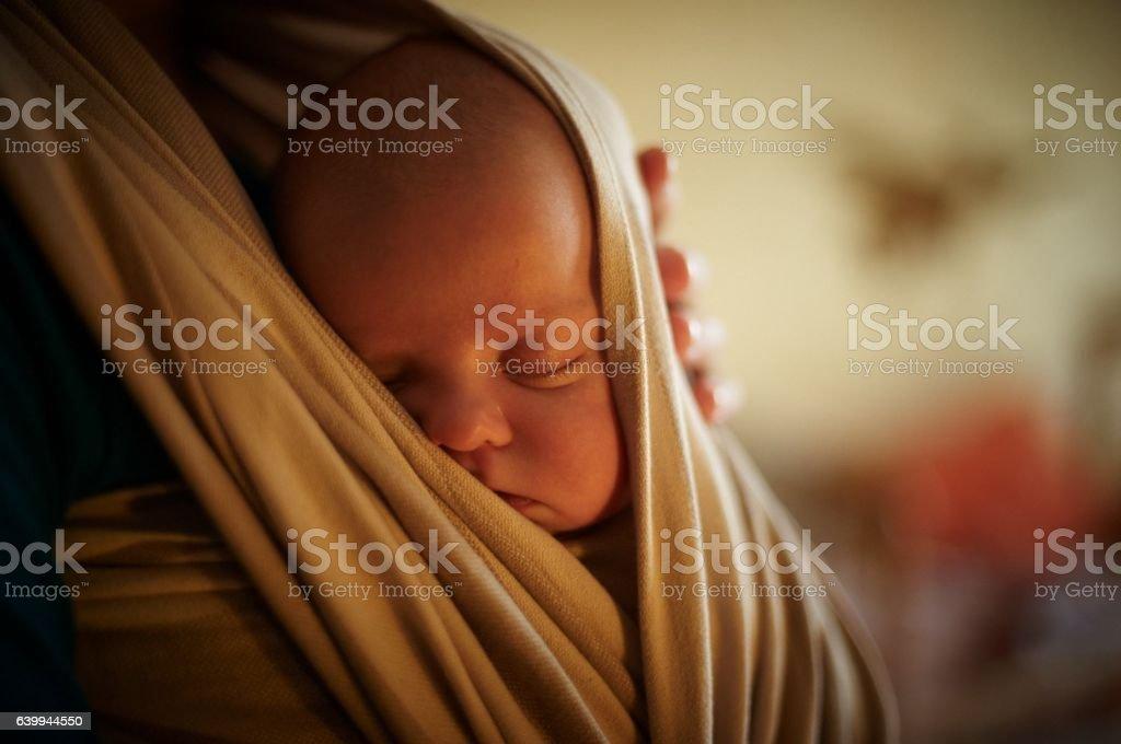 infant in sling stock photo
