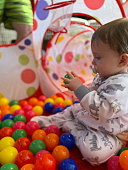 istock Infant playing in a ballpen 1203277670