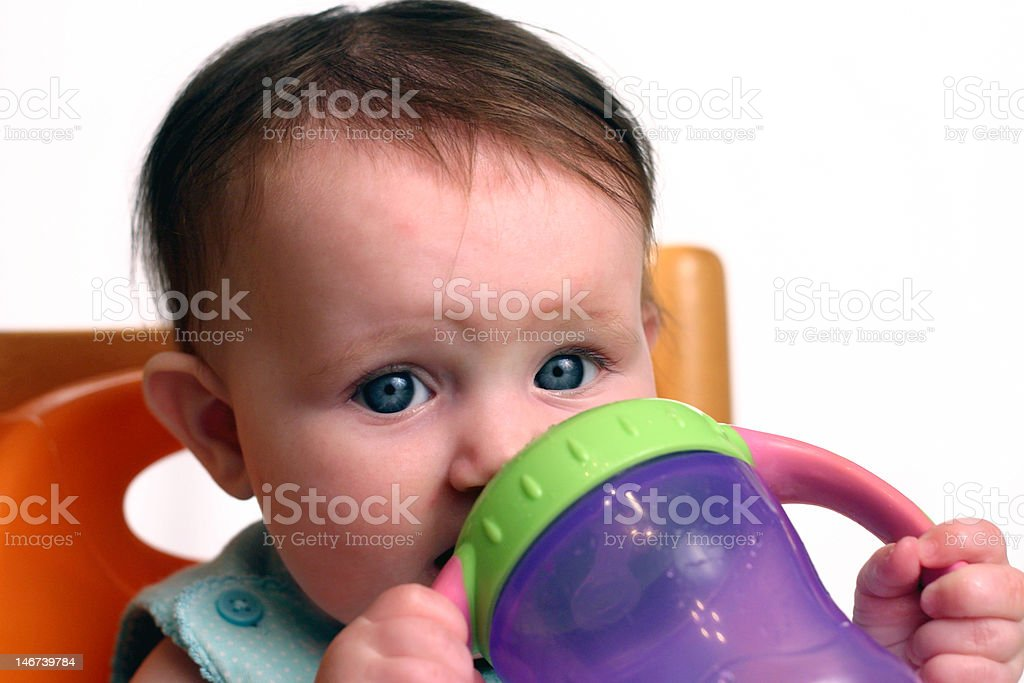 Infant with Sippy Cup stock photo