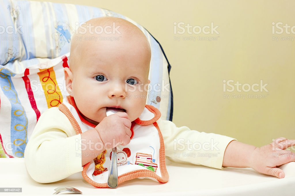 Infant with spoon royalty-free stock photo