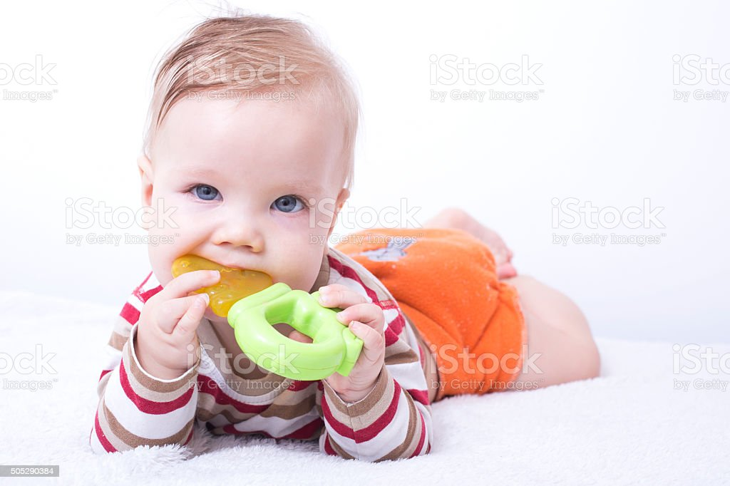 Infant with the teether stock photo