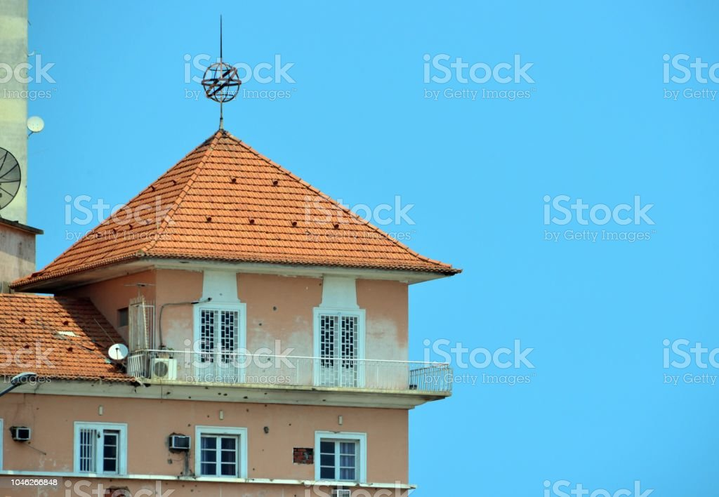 Infante Dom Henrique Square - colonial period building with bullet holes, Luanda, Angola stock photo