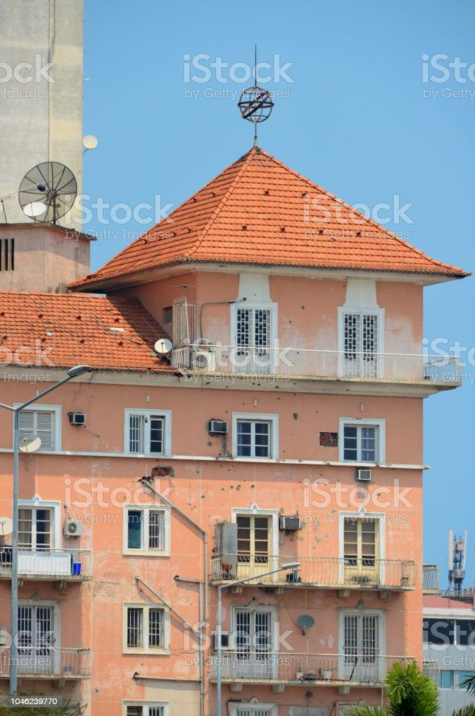 Infante Dom Henrique Square - Portuguese colonial period building with bullet holes, Luanda, Angola stock photo