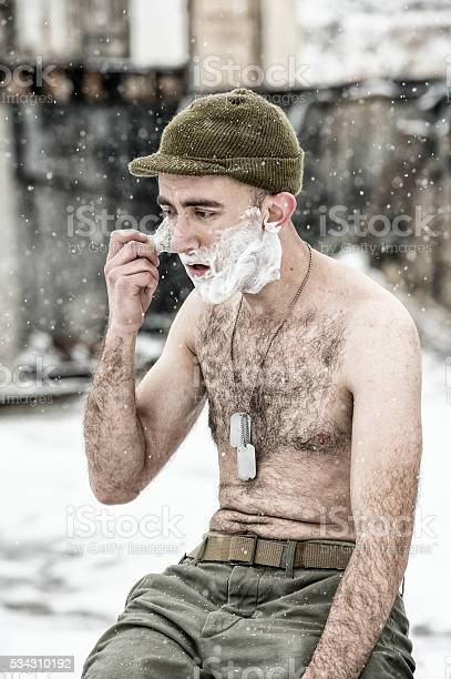 WWII US Infantry Soldier Shaving Shirtless Outdoors