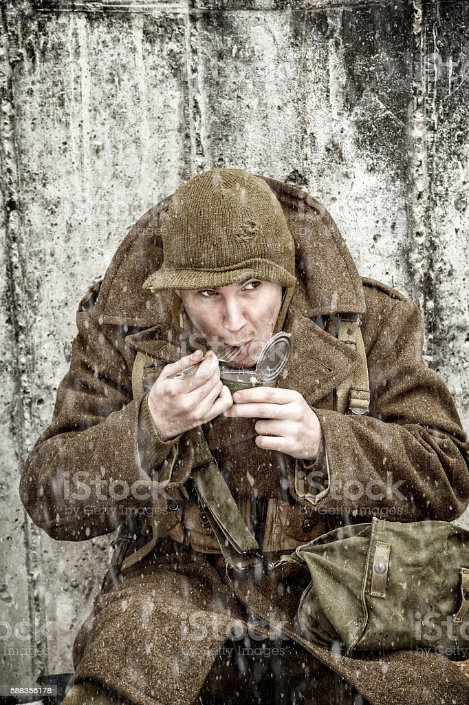 WWII Infantryman Eating With Goverment Issued Fork stock photo