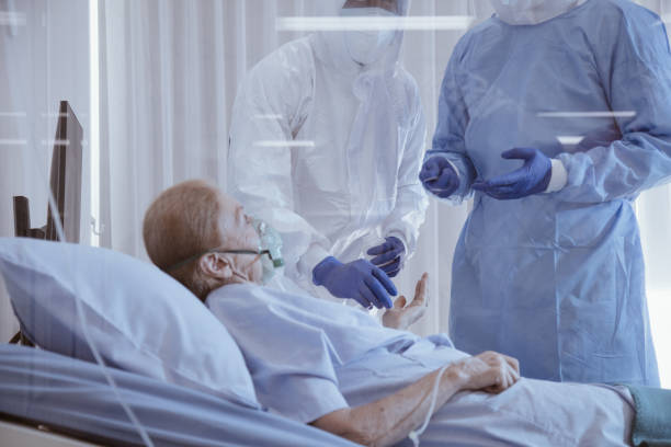 Infected covid-19 patient on takecare of Doctor and nurse stock photo