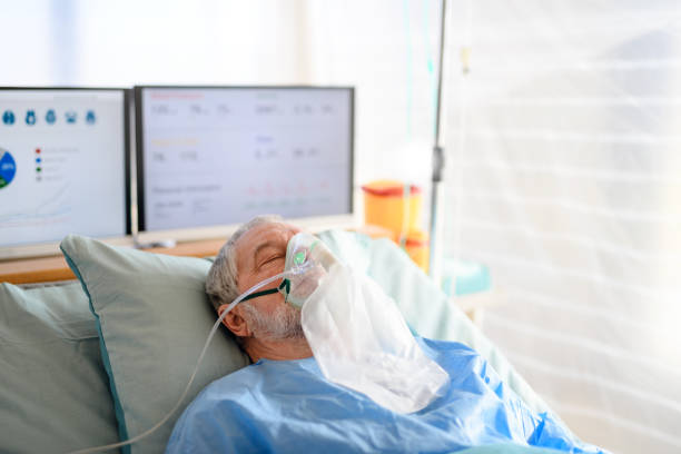 Infected patient in quarantine lying in bed in hospital, coronavirus concept. stock photo
