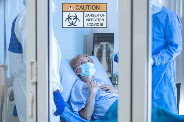 Infected patient on takecare of Doctor and nurse lying on bed in hospital from coronavirus covid 19 disease. stock photo