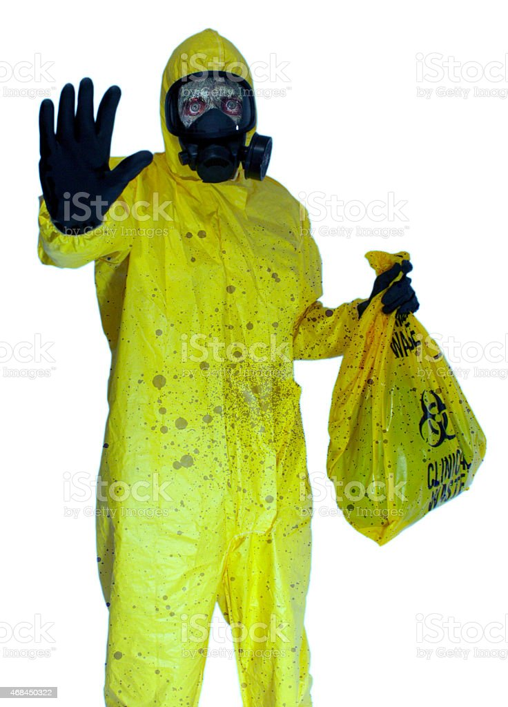 Infected Zombie Wearing Hazmat Suit Carries Bag Of Toxic Waste stock photo
