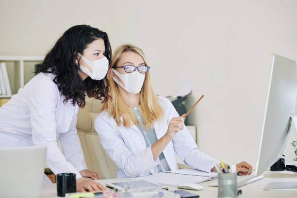 Infectious disease specialists discussing coronavirus data stock photo