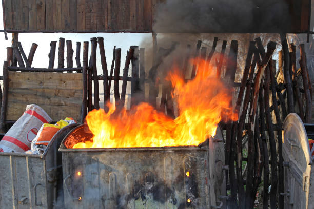 Inferno Dumpster Burning Dumpster Fire Smoke Pollution Communal Problem dumpster fire stock pictures, royalty-free photos & images