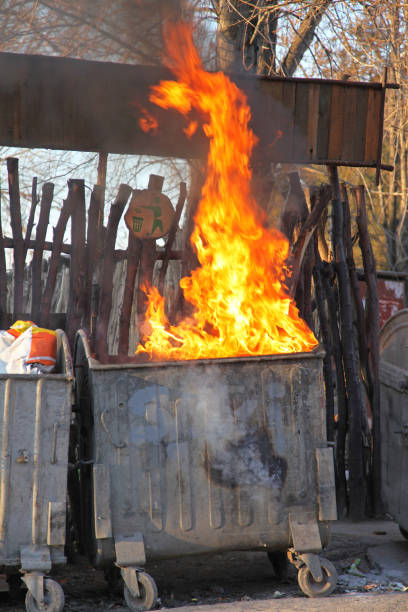 Inferno Fire Dumpster Fire With Inferno Flames From Garbage dumpster fire stock pictures, royalty-free photos & images