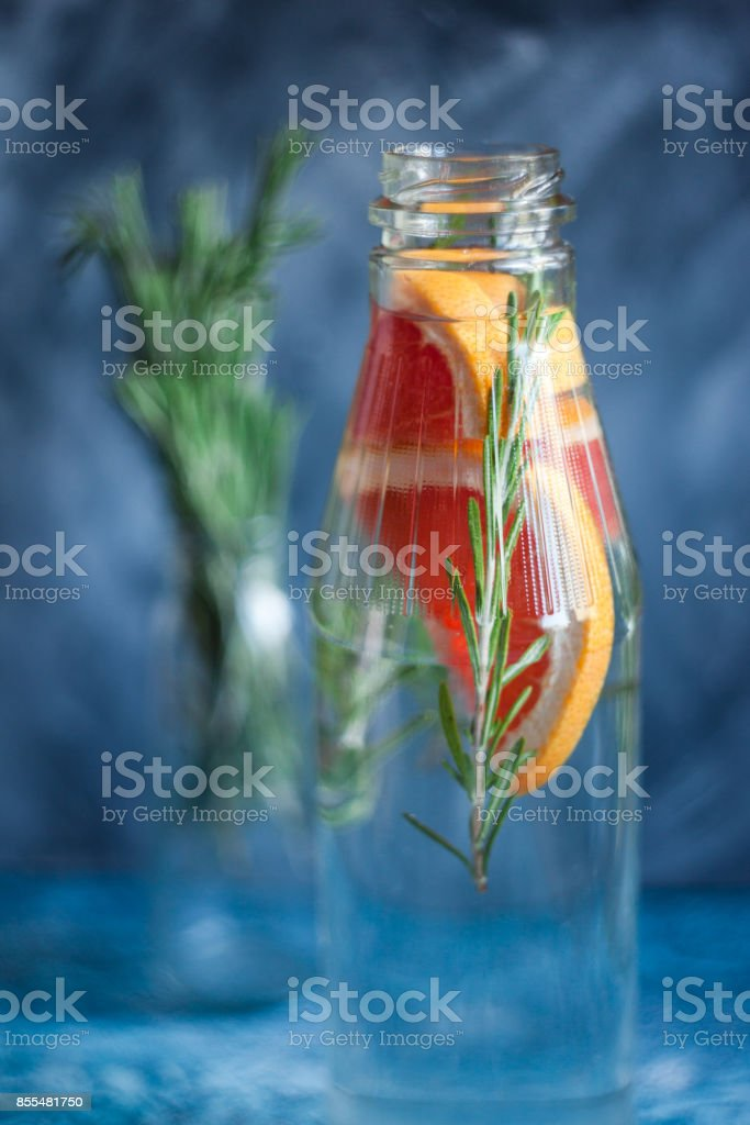 Infesed water recipe. Grapefruit and rosemary detox water. Healthy lifestyle concrpt. Healthy habbit of hydratation. stock photo