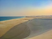 Beach and dunes in a dramatic light at the Qatar's border with Saudi Arabia
