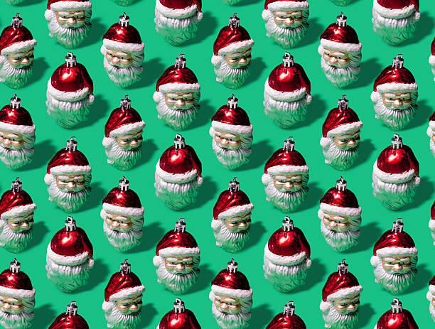 infinite santas wrapping paper - vintage ornaments stock photos and pictures