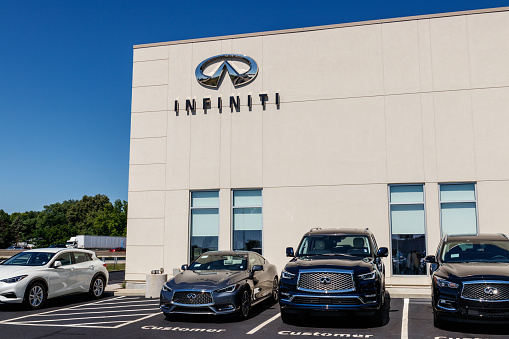 istock Infiniti Car and SUV Dealership. Infiniti is the Luxury Vehicle Division of Nissan II 1000935972