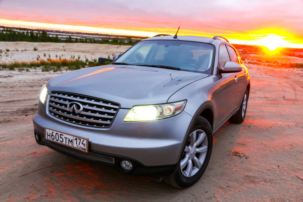 Infiniti FX35 Novyy Urengoy, Russia - July 1, 2018: Grey crossover Infiniti FX35 at the countryside at the background of sunrise. fx network stock pictures, royalty-free photos & images