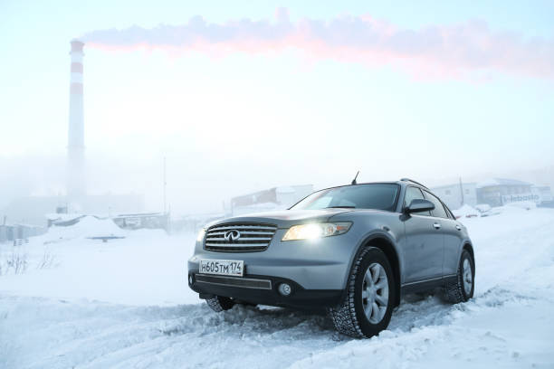Infiniti FX35 Novyy Urengoy, Russia - December 22, 2018: Motor car Infiniti FX35 in the city street during a heavy frost with a fog. fx network stock pictures, royalty-free photos & images