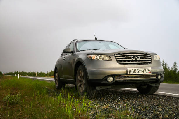 Infiniti FX35 Novyy Urengoy, Russia - June 22, 2018: Motor car Infiniti FX35 at the interurban road. fx network stock pictures, royalty-free photos & images