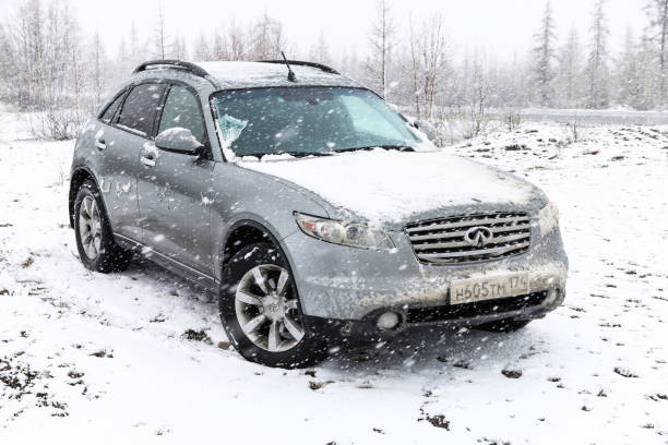 Infiniti FX35 Novyy Urengoy, Russia - June 14, 2019: Motor car Infiniti FX35 at the countryside during a heavy snowfall. fx network stock pictures, royalty-free photos & images