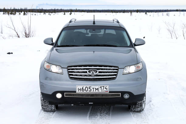 Infiniti FX35 NOVYY URENGOY, RUSSIA - MARCH 4, 2017: Grey motor car Infiniti FX35 in the snow covered tundra. fx network stock pictures, royalty-free photos & images