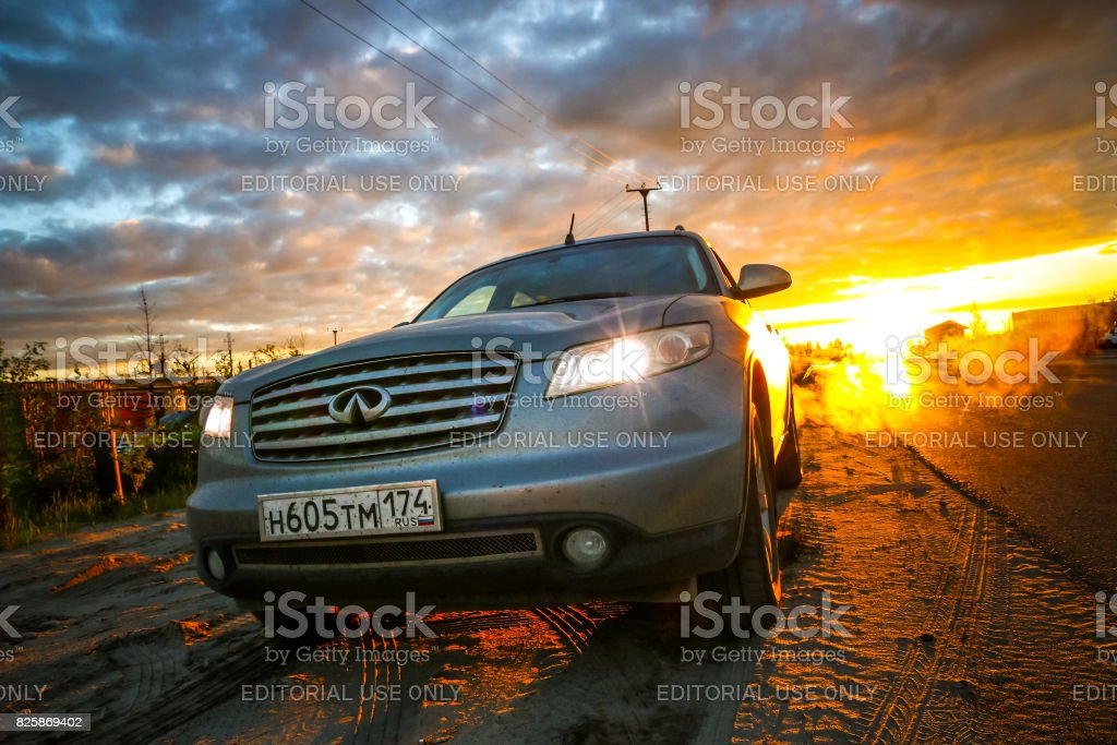 Infiniti FX35 NOVYY URENGOY, RUSSIA - JULY 2. 2017: Grey motor car Infiniti FX35 at the background of the dawn during the midnight sun. 4x4 Stock Photo